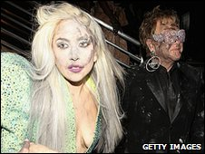 Lady GaGa and Sir Elton John got dirty as they opened the ceremony